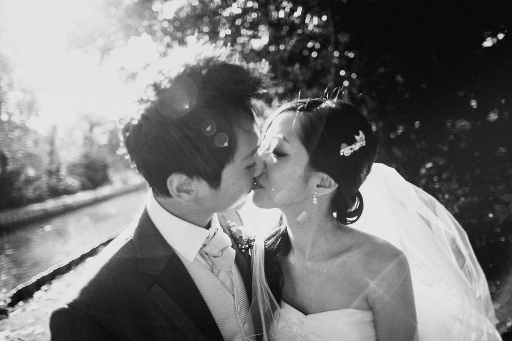 nicholas-lau-nicholau-weddings-london-film-photography-beautiful-pretty-blog-first-wedding-love-cute-white-dress-chinese-asian-black-and-white-bride-newlywed-groom-kiss-sun