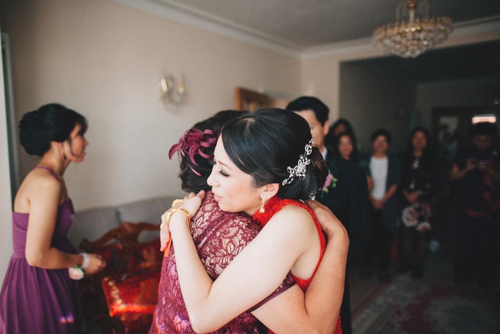 nicholas-lau-nicholau-weddings-london-world-global-film-photography-beautiful-pretty-blog-first-wedding-love-cute-white-dress-chinese-asian-cheongsam-tea-ceremony-hug-hugging-mother-of-the-bride-in-law