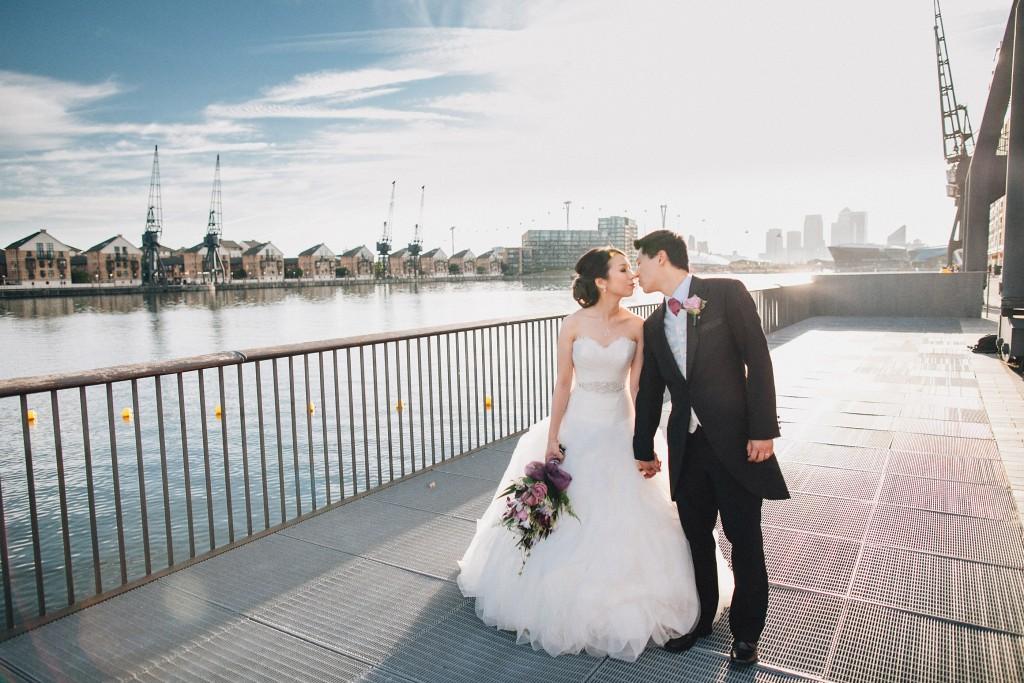 nicholas-lau-nicholau-weddings-london-world-global-film-photography-beautiful-pretty-blog-first-wedding-love-cute-white-dress-chinese-asian-couple-groom=bride-kissing-bouquet-bridge-thames