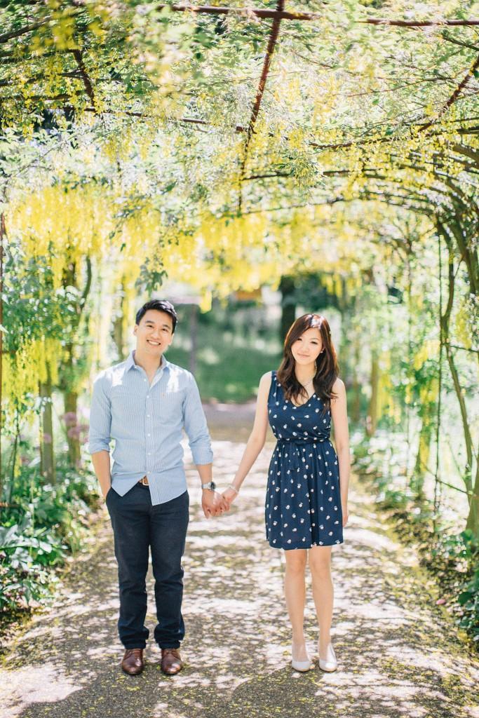 nicholas-lau-nicholau-beautiful-film-photography-love-london-engagement-couple-sunlight-summer-chinese-asian-petersham-nurseries-richmond-park-arbor-vineyard-vines-canopy-holding-hands