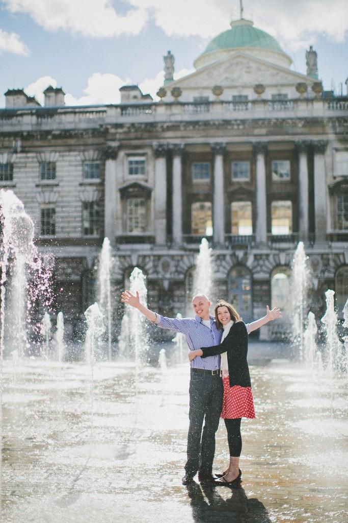 nicholas-lau-nicholau-lincolns-inns-fields-somerset-house-engagement-couple-photos-prewedding-love-london-arms-wide-hello-world-hugging-fountains-sun