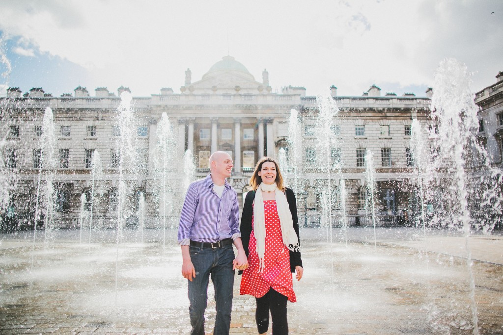 nicholas-lau-nicholau-lincolns-inns-fields-somerset-house-engagement-couple-photos-prewedding-love-london-fountains-white-clouds-sun-smiling-laughing-holding-hands-sunny-sun