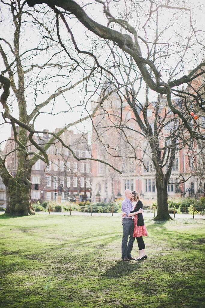 nicholas-lau-nicholau-lincolns-inns-fields-somerset-house-engagement-couple-photos-prewedding-love-london-trees-springe-old-city-polka-dot-dress