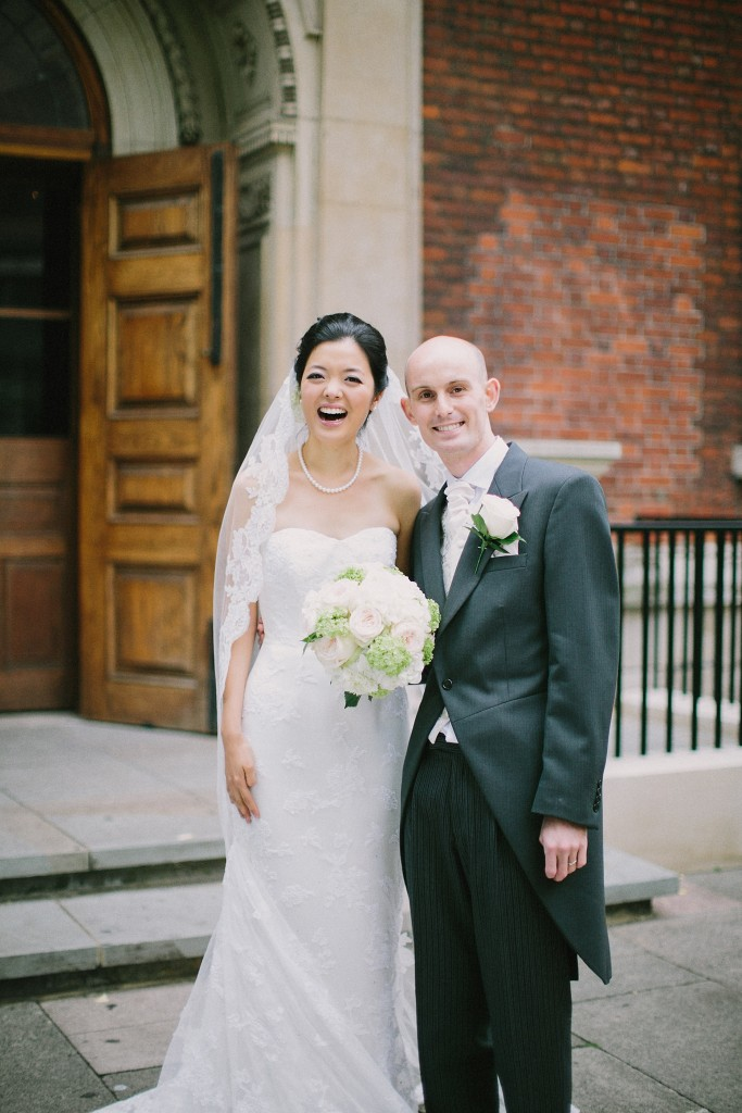 nicholau-nicholas-lau-interracial-wedding-bride-groom-dressed-up-in-front-of-church-happy-white-korean