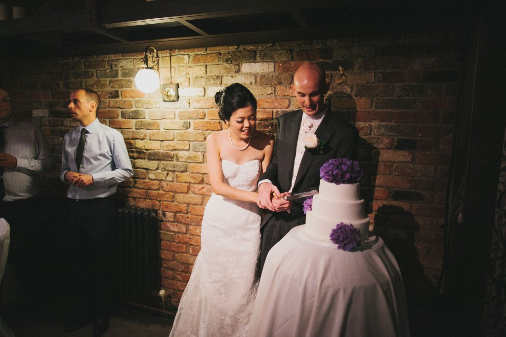 nicholau-nicholas-lau-interracial-wedding-cut-the-cake-three-tier-purple-and-white-cake