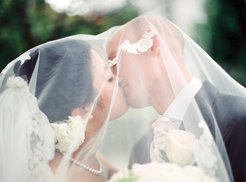 nicholau-nicholas-lau-interracial-wedding-kissing-bride-and-groom-under-a-veil-korean-white-caucasian