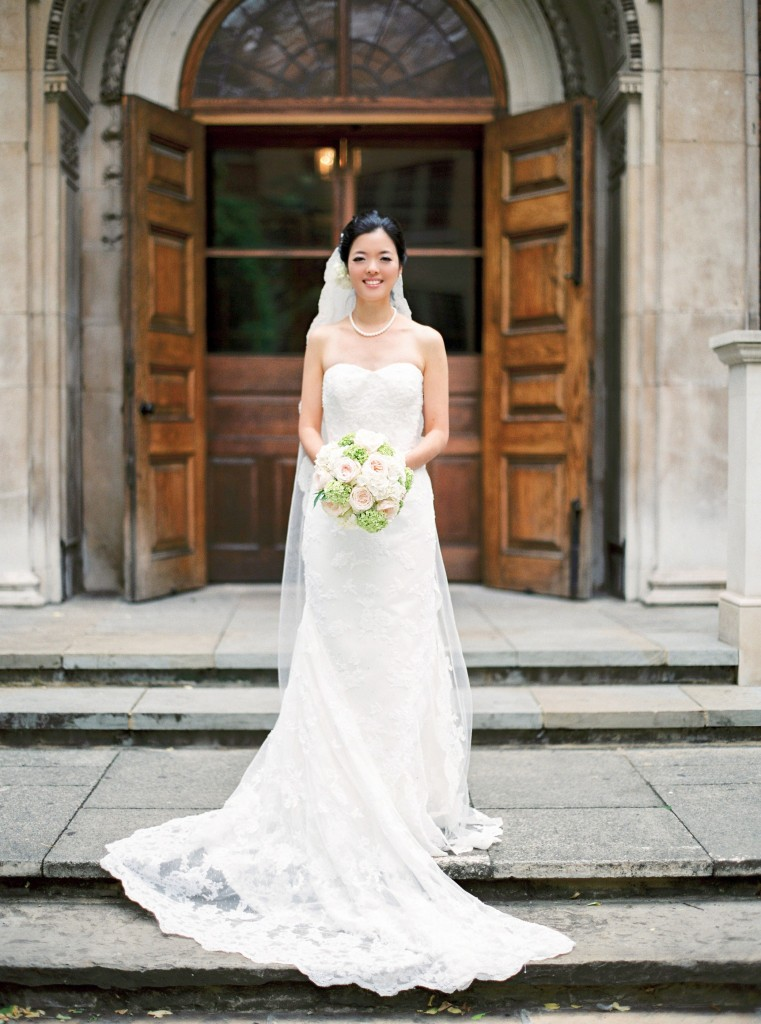 nicholau-nicholas-lau-interracial-wedding-korean-bride-in-front-of-church-doors-bouquet-veil-mermaid-gown-dress