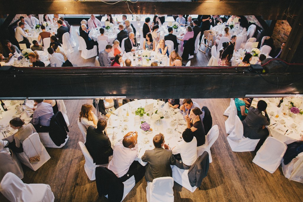 nicholau-nicholas-lau-interracial-wedding-overview-guests-tables-reception-beam