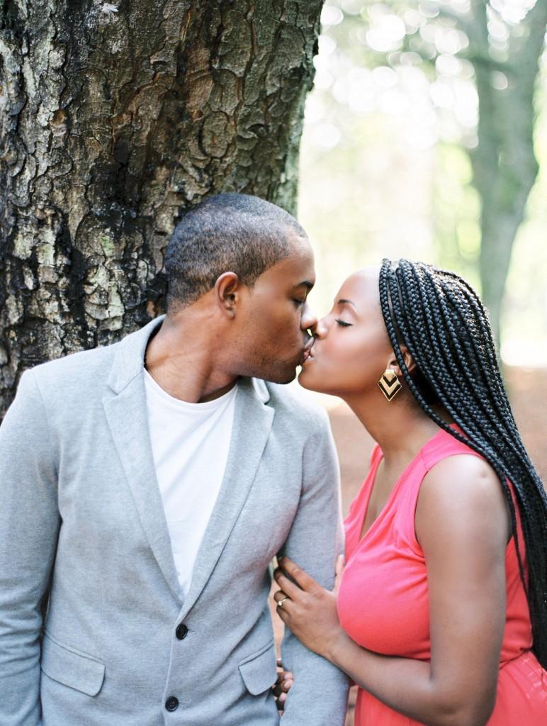 nicholau-nicholas-lau-photography-couples-session-pre-wedding-engagement-love-african-london-coral-dress-grey-blazer-braids-peck-kisses