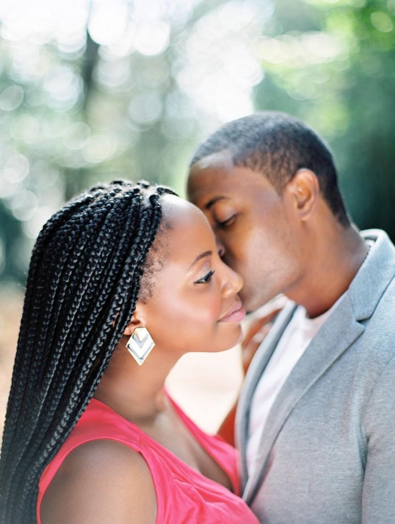 nicholau-nicholas-lau-photography-couples-session-pre-wedding-engagement-love-african-london-kiss-on-the-cheek-black-ebony-braids-outdoor-sun