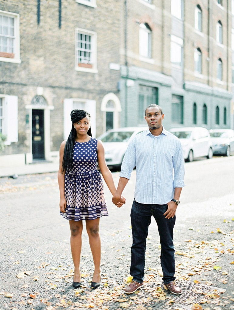 nicholau-nicholas-lau-photography-couples-session-pre-wedding-engagement-love-african-london-leaves-fall-street-holding-hands-stand-proud-together-jeans-purple-dress-braids