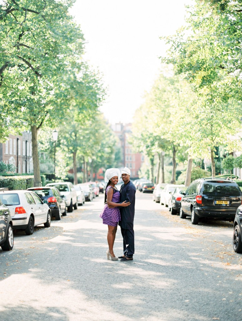 nicholau-nicholas-lau-photography-couples-session-pre-wedding-engagement-love-african-london-tree-lined-street-black-gele-jeans-purple-dress