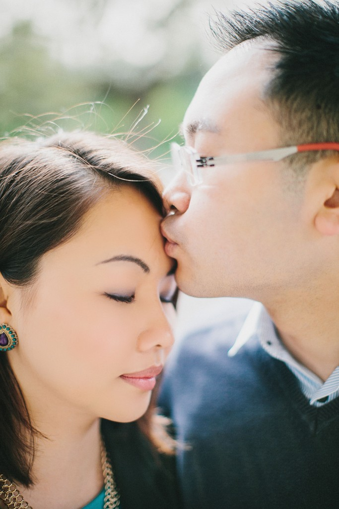 nicholas-lau-nicholau-engagement-spring-photography-peony-and-mockingbird-chinese-couple-battersea-park-westminster-something-blue-kiss-peck-stand-tall-together-c