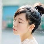 nicholas-lau-nicholau-katrina-li-taiwan-travel-photography-portraits-beach-taipei-kaohsiung-eos3-fuji-flim-400h-top-knot-hair-style-sun-serene
