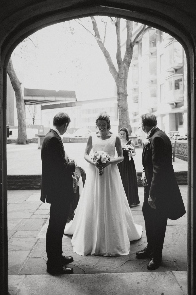 nicholas-lau-nicholau-london-weddings-fine-art-photography-leadenhall-market-st-helens-church-documentary-style-black-white-bride-enters