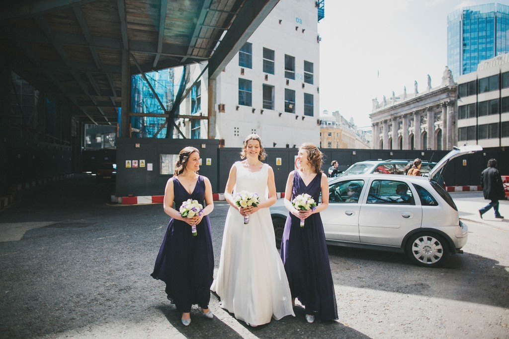 nicholas-lau-nicholau-london-weddings-fine-art-photography-leadenhall-market-st-helens-church-documentary-style-bride-with-her-hens-bridesmaids-walking-together-dresses-navy-white