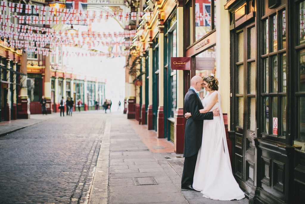 nicholas-lau-nicholau-london-weddings-fine-art-photography-leadenhall-market-st-helens-church-documentary-style-telepathy-forehead-headbutt-bride-groom