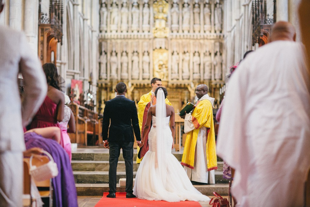 Nicholau-nicholas-lau-photography-london-uk-wedding-fine-art-film-nigerian-black-african-traditional-alter-vicor-preacher-vows-prayers-perspective