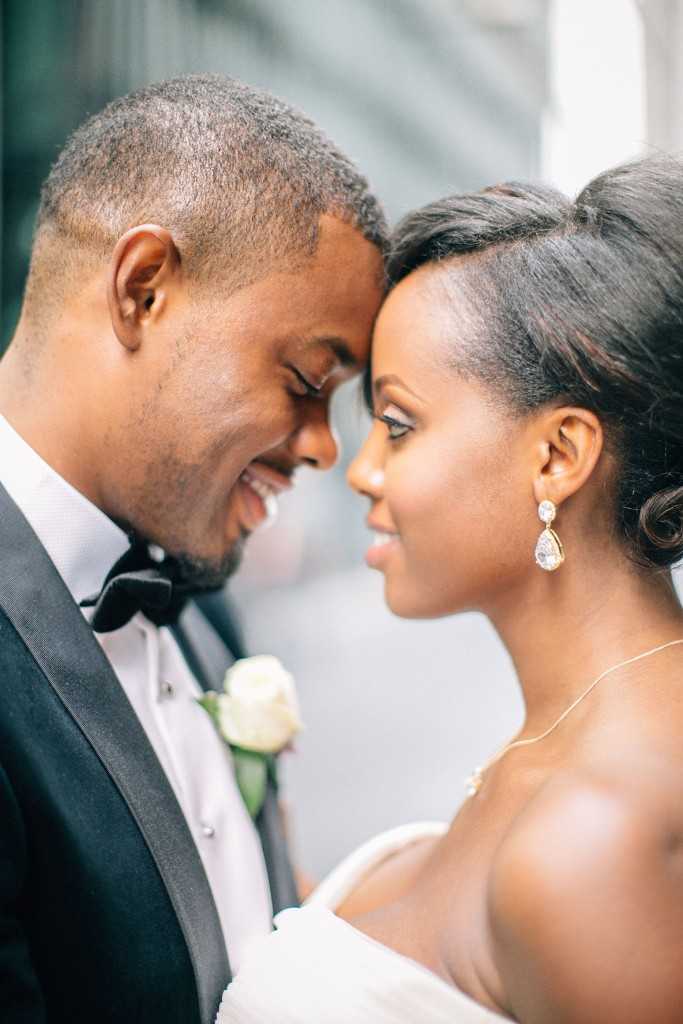 Nicholau-nicholas-lau-photography-london-uk-wedding-fine-art-film-nigerian-black-african-traditional-bowtie-tuxedo-sweetheart-neckline-forehead-kiss-touch-admiration