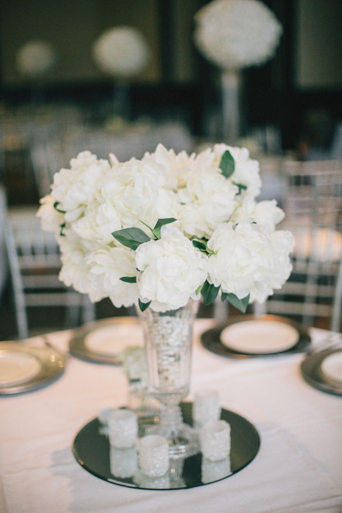 Nicholau-nicholas-lau-photography-london-uk-wedding-fine-art-film-nigerian-black-african-traditional-center-piece-roses-white-table-setting