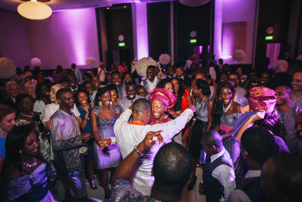 Nicholau-nicholas-lau-photography-london-uk-wedding-fine-art-film-nigerian-black-african-traditional-dancing-magenta-bride-husband-reception-kele
