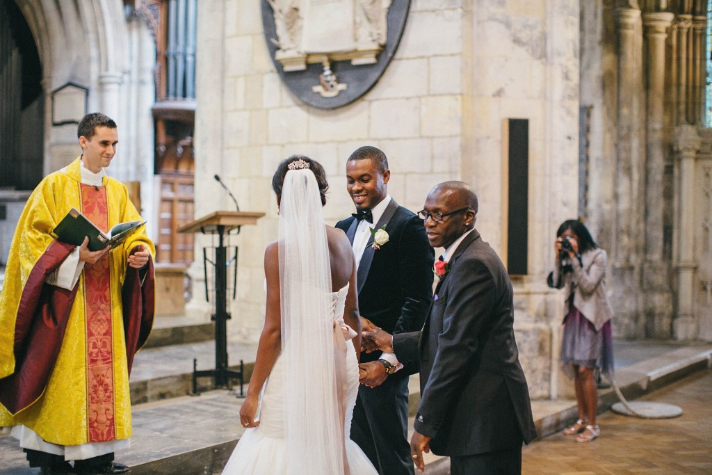 Nicholau-nicholas-lau-photography-london-uk-wedding-fine-art-film-nigerian-black-african-traditional-groom-bride-aisle-preacher-ceremony-vows