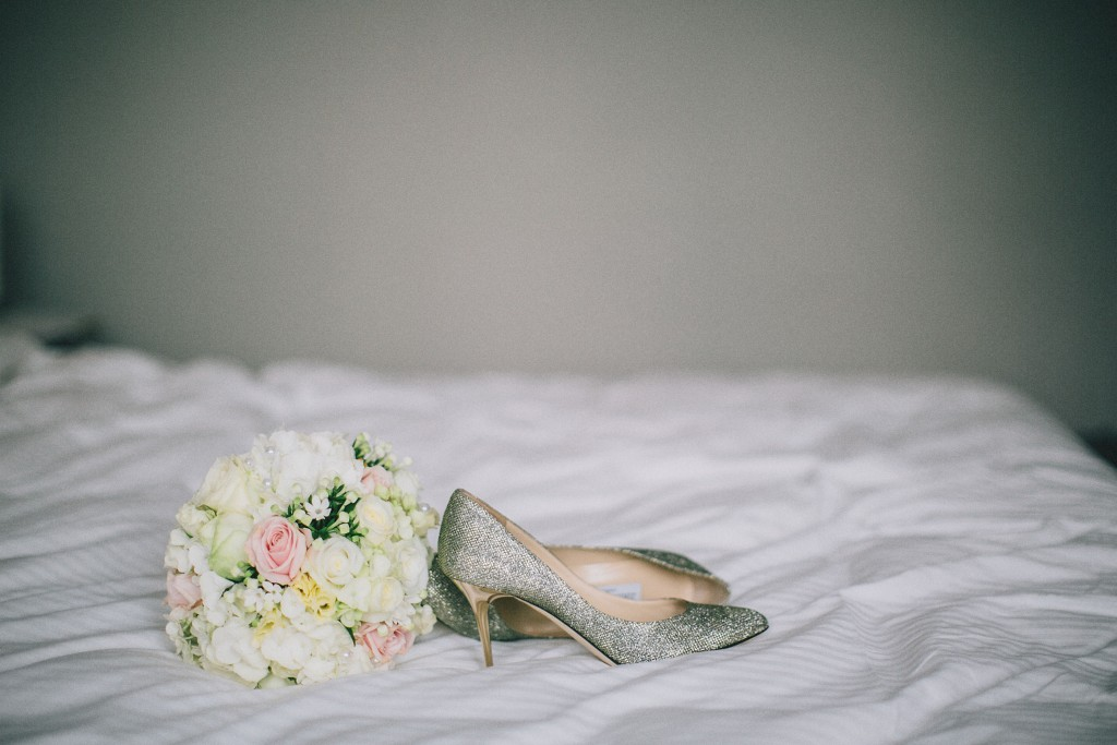 Nicholau-nicholas-lau-photography-london-uk-wedding-fine-art-film-nigerian-black-african-traditional-heels-shoes-bed-bouquet-bride-getting-ready