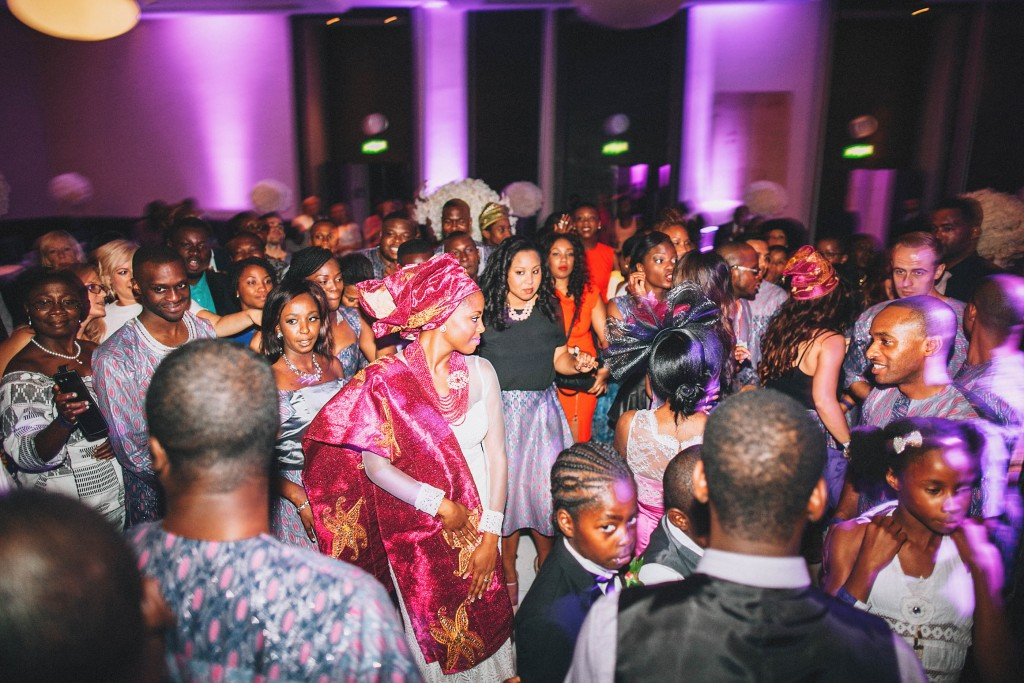 Nicholau-nicholas-lau-photography-london-uk-wedding-fine-art-film-nigerian-black-african-traditional-kele-robe-bride-dancing-magenta-party-reception