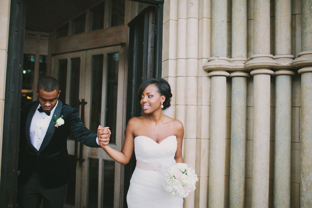 Nicholau-nicholas-lau-photography-london-uk-wedding-fine-art-film-nigerian-black-african-traditional-leading-out-from-the-chruch-bride-bouquet-hold-my-hand