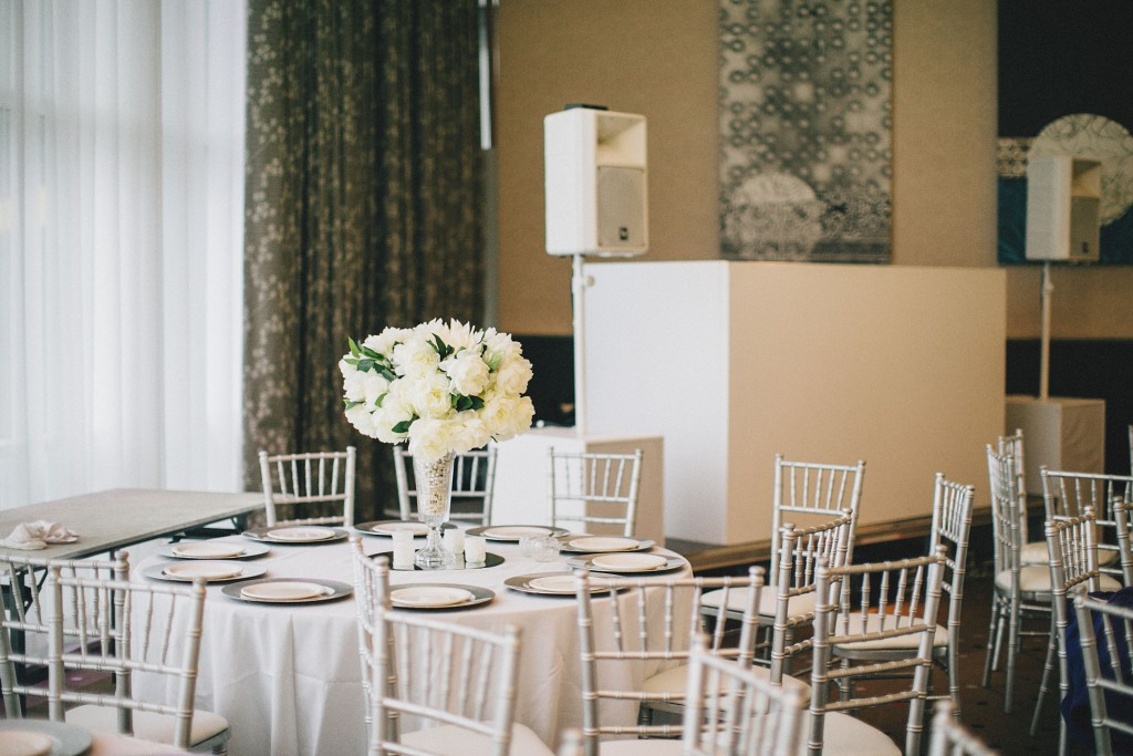 Nicholau-nicholas-lau-photography-london-uk-wedding-fine-art-film-nigerian-black-african-traditional-reception-silver-chairs-