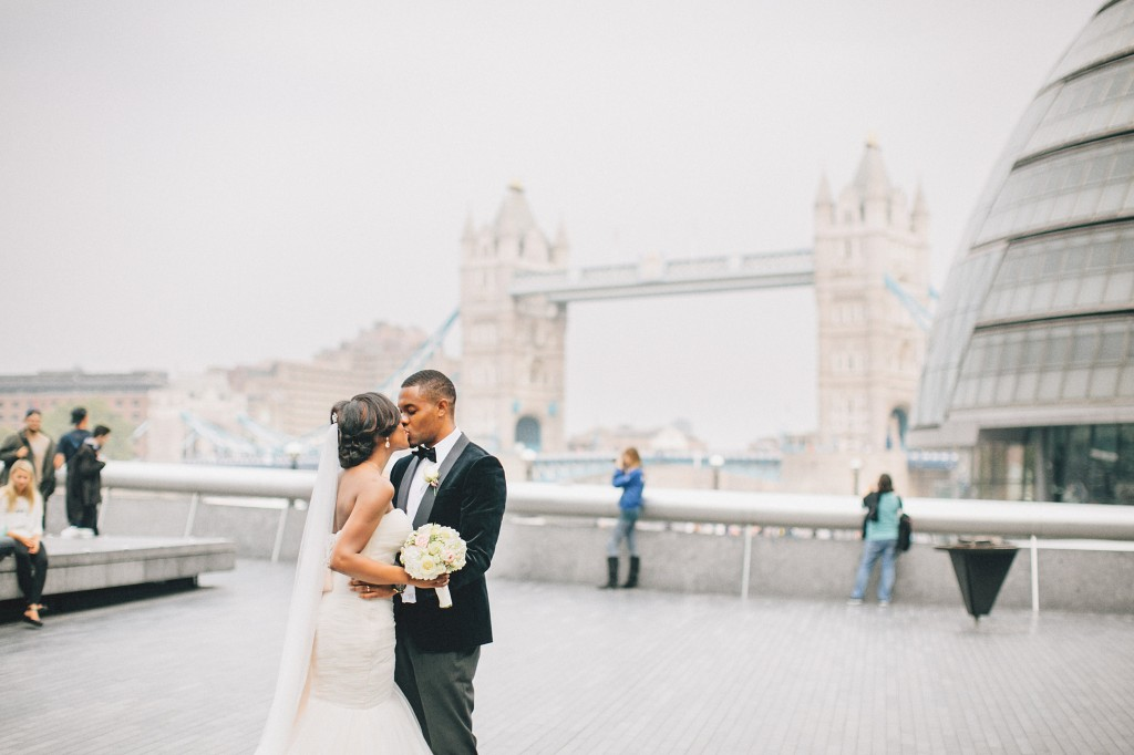Nicholau-nicholas-lau-photography-london-uk-wedding-fine-art-film-nigerian-black-african-traditional-tower-bridge-kissing-bride-groom-tux-gown-veil