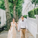 nicholas-lau-nicholau-romance-london-uk-engagement-asian-chinese-hong-kong-couple-photography-film-fine-art-holland-park-house-of-parliament-south-bank-waterloo-progressive-couple-hold-hands-green-trees-fence-wall