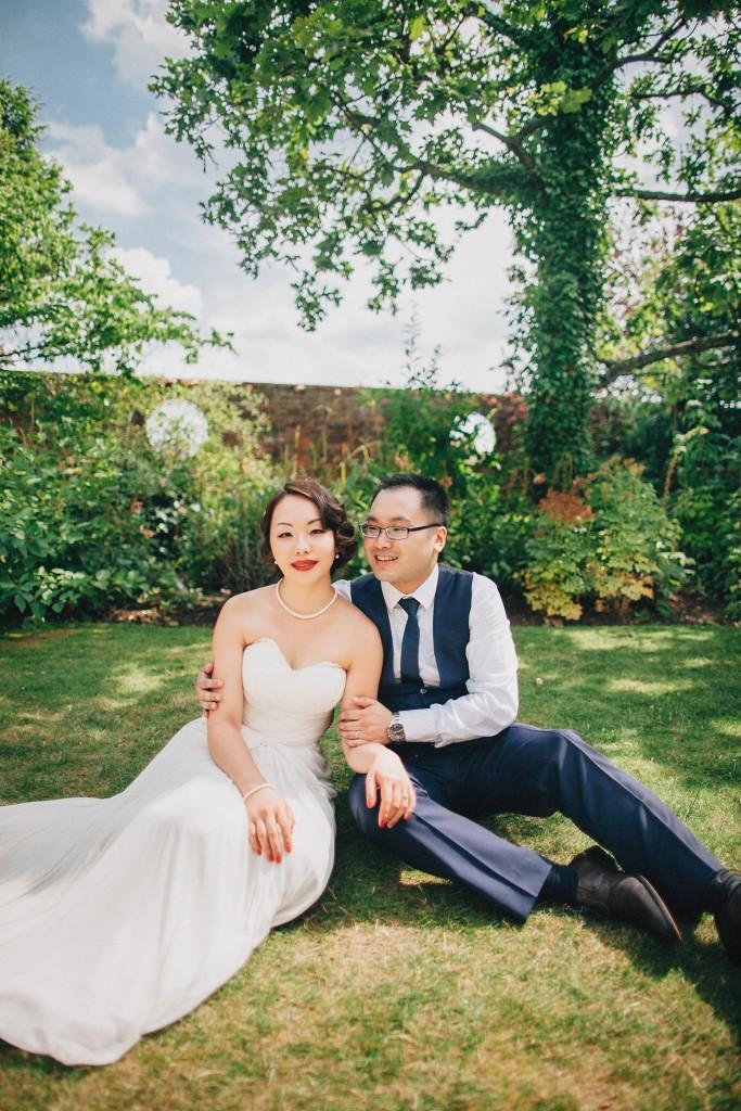 Nicholas-lau-nicholau-wedding-fine-art-film-photography-love-london-uk-chinese-asian-kensington-roof-gardens-grass-dress-bride-groom