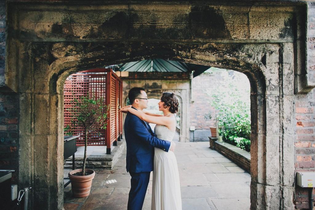nicholau-nicholas-lau-wedding-fine-art-photography-london-chinese-asian-hands-on-shoulders-bride-groom-hug-embrance-kensington-arch-gardens-path