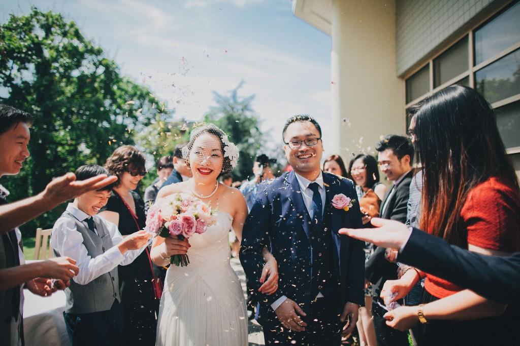 nicholau-nicholas-lau-wedding-fine-art-photography-london-chinese-asian-just-married-bride-groom-happy-smiling-throw-rice-bouquet-blue-suit