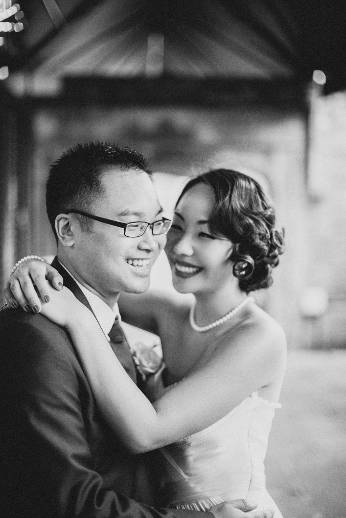 nicholau-nicholas-lau-wedding-fine-art-photography-london-chinese-asian-smiling-at-her-husband-arms-around-neck-happy-couple