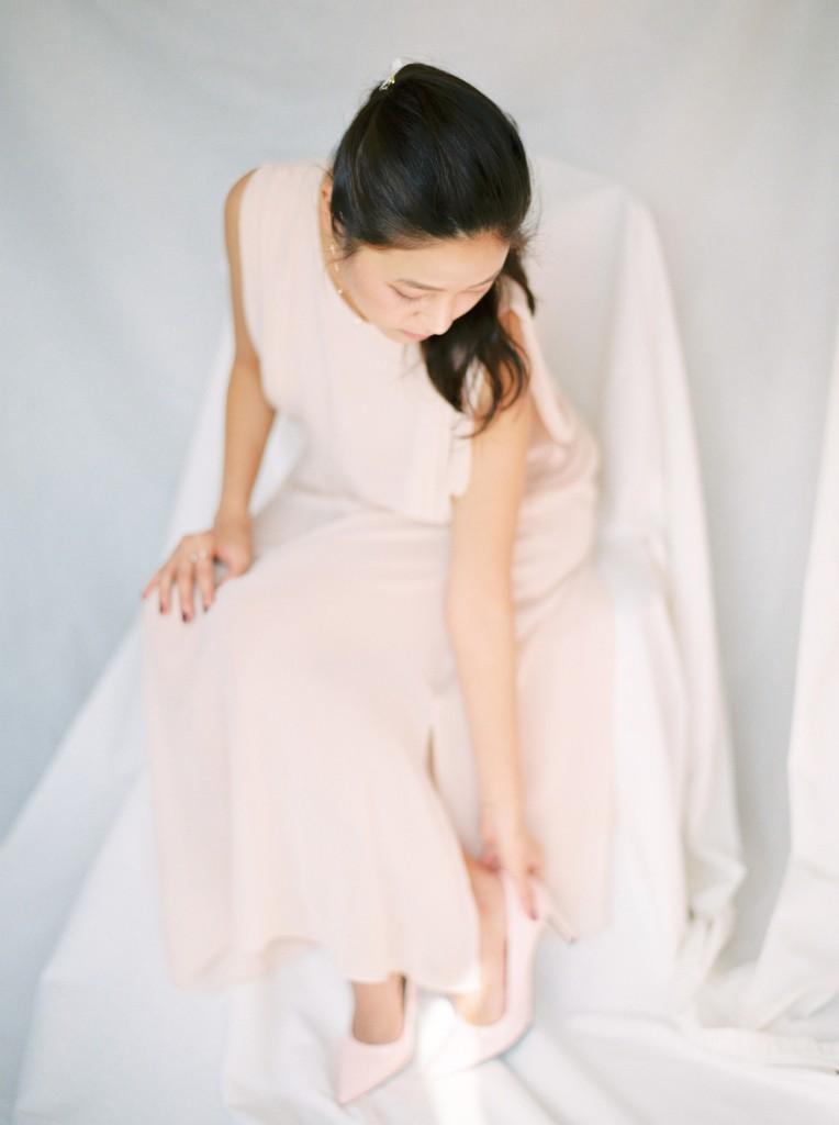 Nicholas-lau-nicholau-film-fine-art-photography-portraits-korean-asian-tea-pot-fuji-400-contax-645-pretty-beautiful-heels-shoes-sitting-peach-dress