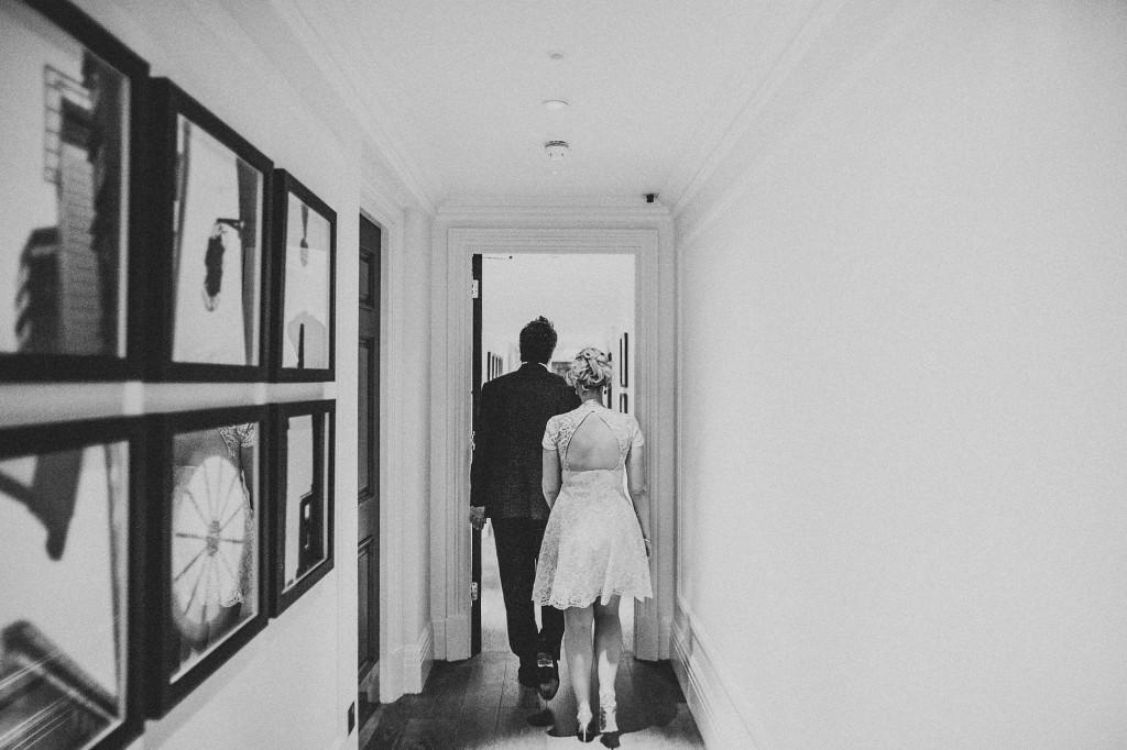 nicholas-lau-nicholau-wedding-photography-photographer-fine-art-film-winter-christmas-london-UK-modern-unique-the-arch-asia-house-bide-groom-walking-down-hallway