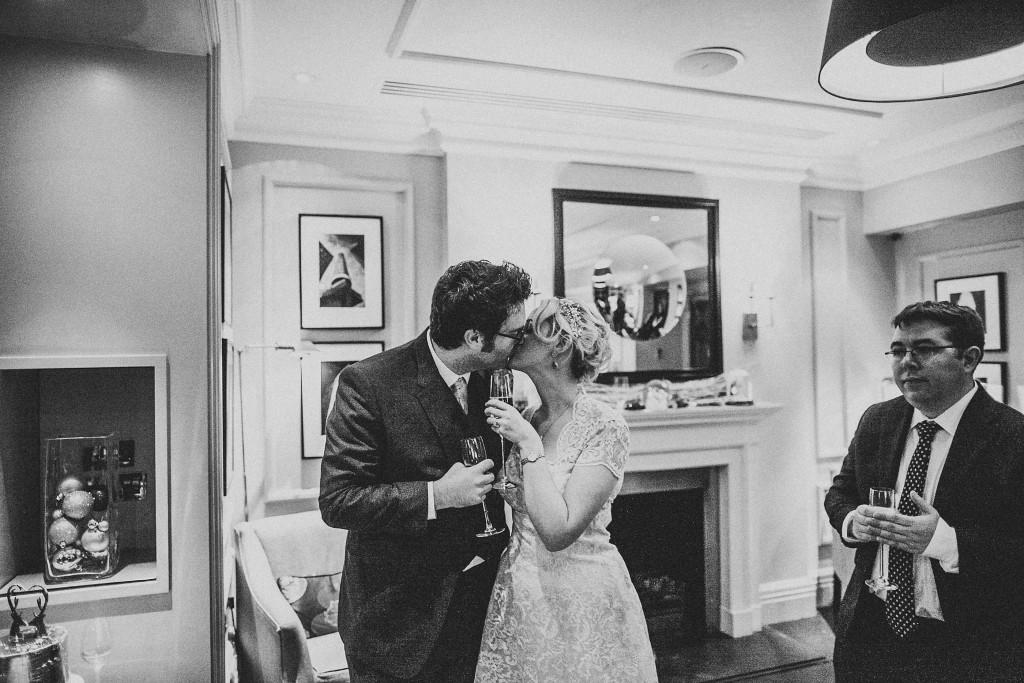 nicholas-lau-nicholau-wedding-photography-photographer-fine-art-film-winter-christmas-london-UK-modern-unique-the-arch-asia-house-black-white-bride-groom-kissing