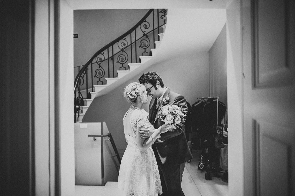nicholas-lau-nicholau-wedding-photography-photographer-fine-art-film-winter-christmas-london-UK-modern-unique-the-arch-asia-house-black-white-kiss-groom-bride