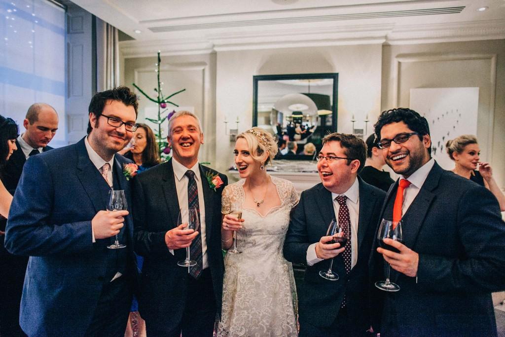 nicholas-lau-nicholau-wedding-photography-photographer-fine-art-film-winter-christmas-london-UK-modern-unique-the-arch-asia-house-bride-bunch-of-guys-blue-suit