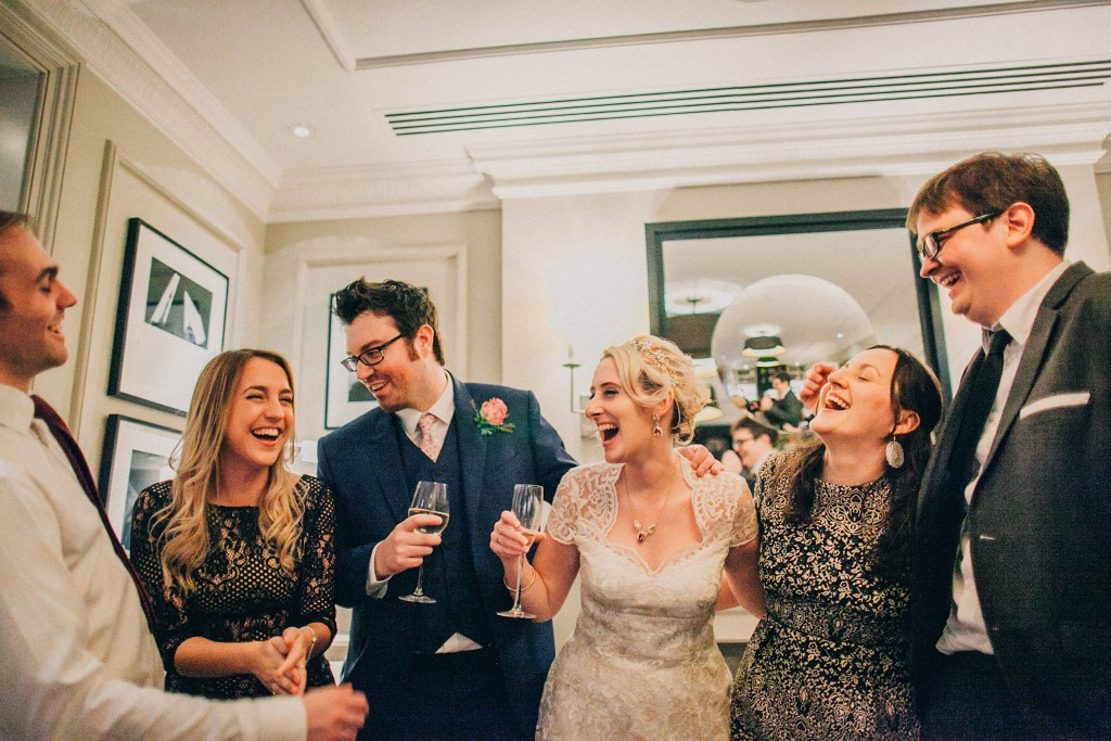nicholas-lau-nicholau-wedding-photography-photographer-fine-art-film-winter-christmas-london-UK-modern-unique-the-arch-asia-house-bride-groom-laughing-guests-reception-blue-suit