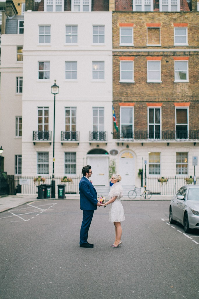 nicholas-lau-nicholau-wedding-photography-photographer-fine-art-film-winter-christmas-london-UK-modern-unique-the-arch-asia-house-bride-groom-walking-together-knee-length-dress