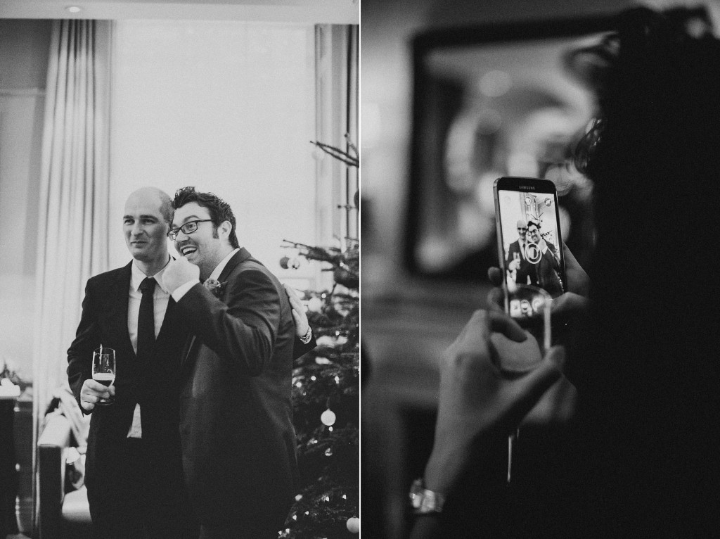 nicholas-lau-nicholau-wedding-photography-photographer-fine-art-film-winter-christmas-london-UK-modern-unique-the-arch-asia-house-cell-phone-photo-groom-ceremony-black-white