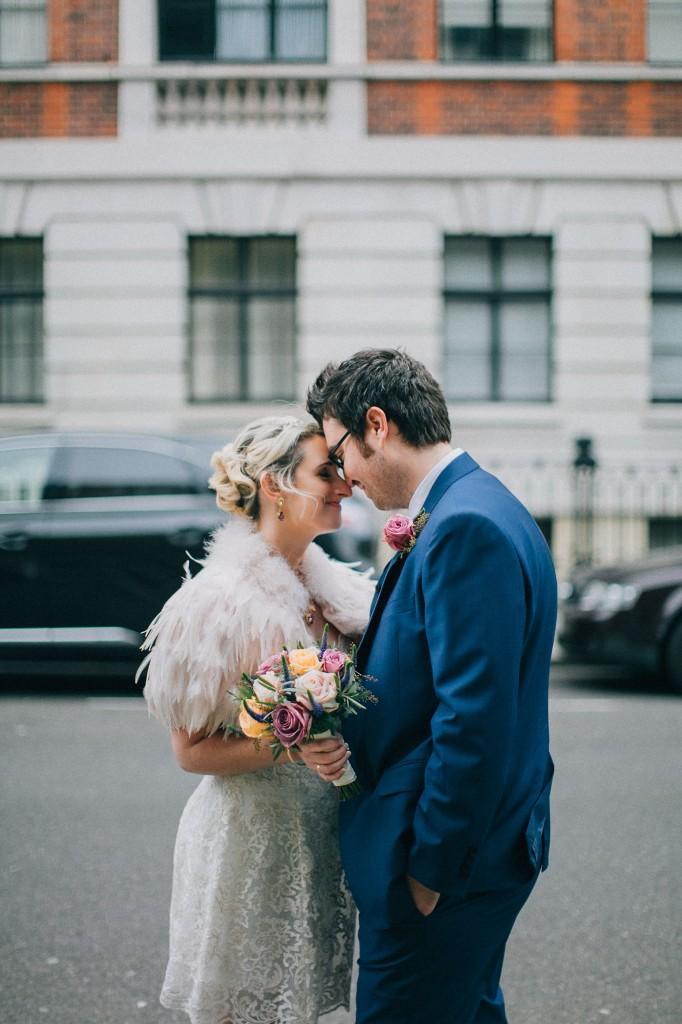 nicholas-lau-nicholau-wedding-photography-photographer-fine-art-film-winter-christmas-london-UK-modern-unique-the-arch-asia-house-forehead-nuzzles-kissing-kiss-bride-groom-blue-suit-white-dress