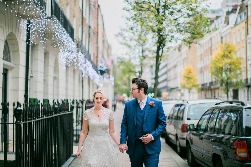 nicholas-lau-nicholau-wedding-photography-photographer-fine-art-film-winter-christmas-london-UK-modern-unique-the-arch-asia-house-knee-length-dress-blue-suit-holding-hands
