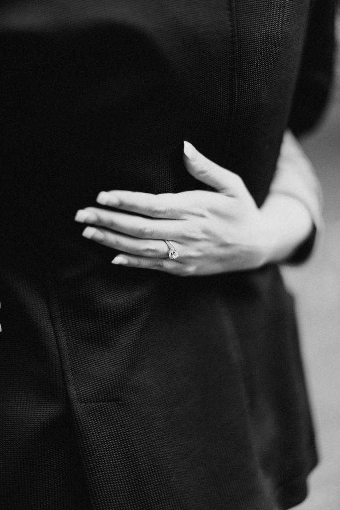 nicholau-nicholas-lau-couple-pre-wedding-film-fine-art-photography-red-blazer-leaves-fall-autumn-kew-gardens-uk-london-engagement-ring-hand-back-blazer-black-white-diamond