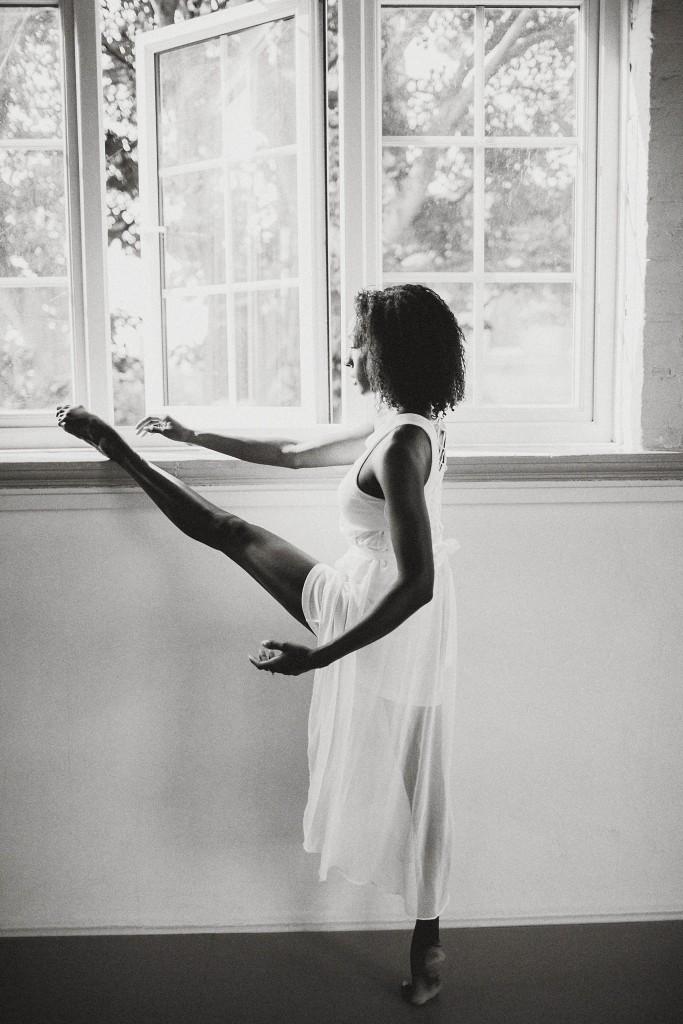 nicholas-lau-photo-photography-uk-london-black-african-american-ballerina-ballet-flats-dancer-dancing-light-sun-sudio-barefoot-stretching-by-the-window