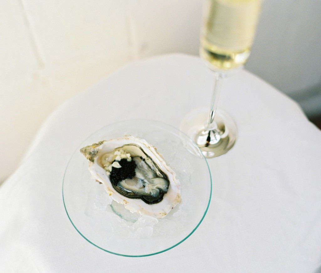 nicholas-lau-photo-photography-oyster-oysters-fruit-de-mer-seafood-lifestyle-film-fuji-contax-645-billingsgate-london-market-maldon-cavier-champagne-flute-glass-on-ice-garlic